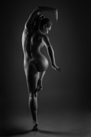 Naked female dancer posing in studio photo