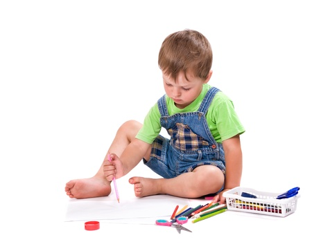 boy draws a pencil sitting on the floor photo