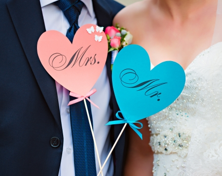 mrs: Couple show hearts card with text MR and MRS