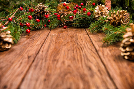 Decorated Christmas fir tree on a wooden board Stock Photo