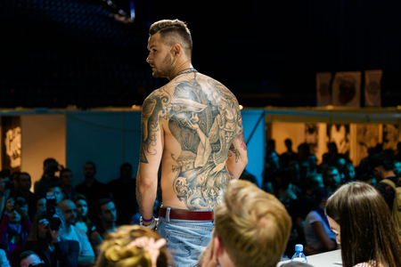 judging: MINSK, BELARUS - SEPTEMBER 19, 2015: People show their tattoos for judging. The 2th International Tattoo Convention