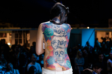 tattoo design: MINSK, BELARUS - SEPTEMBER 19, 2015: People show their tattoos for judging. The 2th International Tattoo Convention