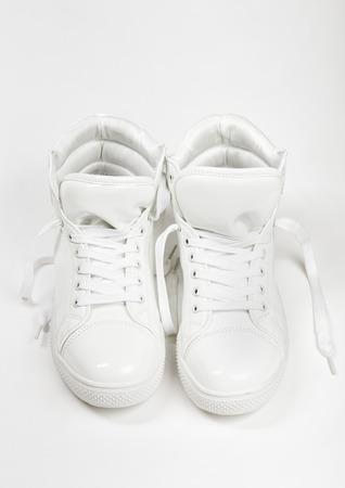 White sneakers on white background
