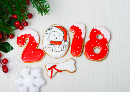 Christmas background with gingerbread, Christmas trees and snowflakes with pine cones. 2018 year of the dog