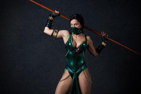 MINSK, BELARUS - NOVEMBER 03, 2018: UniСon Convention & Game Expo Minsk 2018. Cosplayer Mortal Kombat Jade Kitana shoot on black background in photo zone