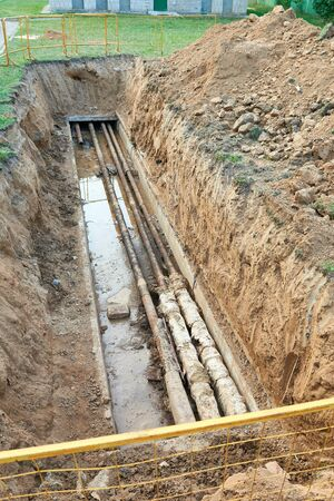 Process of repair or replacement communications, old heat and water pipes in the ground.