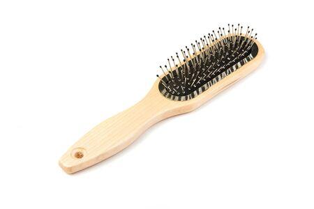 New modern wooden hairbrush isolated on white background.