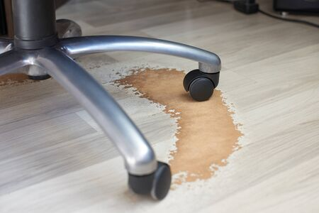 Damaged Laminate Floor from office chair wheels. Stok Fotoğraf