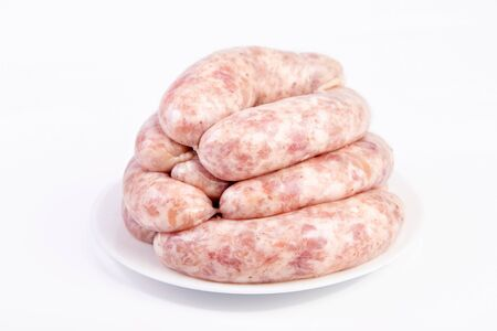 Raw Sausages, Oktoberfest Sausages close-up, isolated on white background. Raw meat