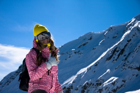 snowboard: Girl in bright clothes in mountains Stock Photo