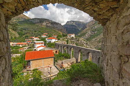 loophole: V  1052;iew of the ancient aqueduct through a loophole Turkish fortress in Stari Bar  Montenegro