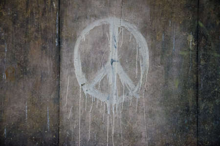 Peace symbol painted on grunge wall photo