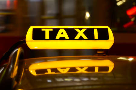 Taxi sign at night  photo