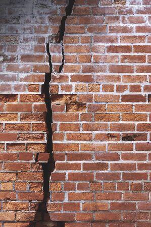 Old brickwork cracks and fissures for background. Imagens