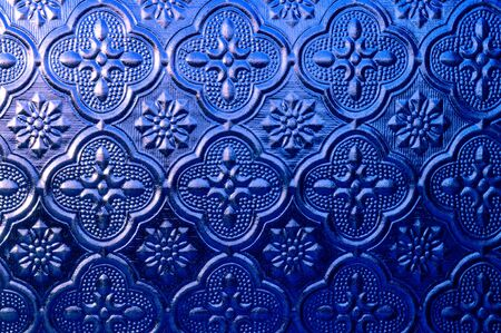 Blue embossed frosted glass, retro glass window craft, close up glass background.