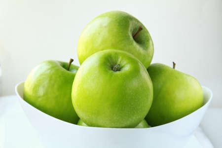 abuela: Elegantes manzanas verdes de Granny Smith Foto de archivo
