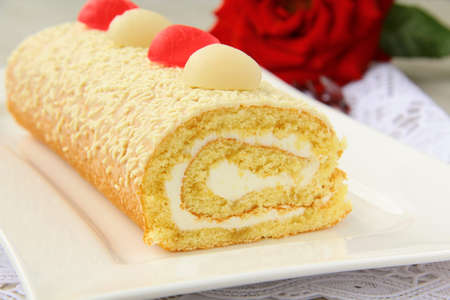 rouleau: biscuit roulade with cream and white chocolate Stock Photo