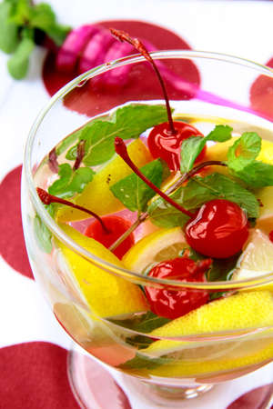 summer drink sangria with fruit in a large glass  photo
