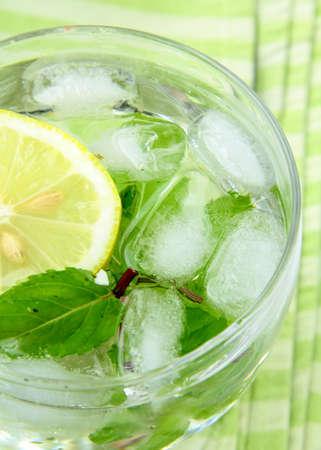 fresh lemon lemonade with mint leaves and ice photo