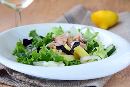 Traditional salad nicoise with fish, onions and potatoes photo