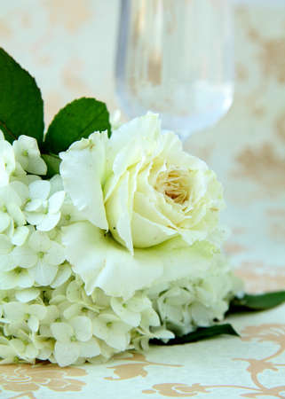 beautiful bridal bouquet of white roses on a vintage background photo