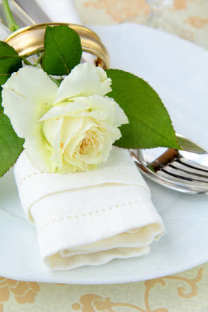 wedding table setting with a white rose photo