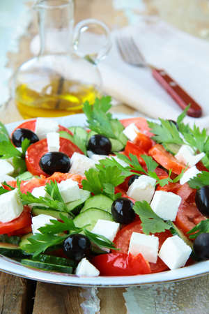 Greek salad with olives, tomatoes and feta cheese photo