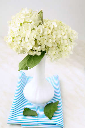 beautiful summer white flowers in a vase  photo