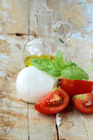 Italian mozzarella cheese with tomato and basil photo