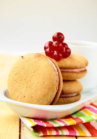 biscuits with cream and red currant photo