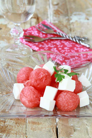 Watermelon salad with feta cheese and greens  photo