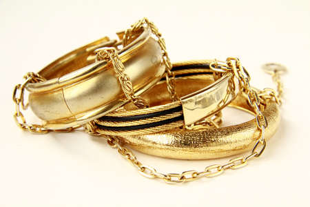 gold rings: gold female jewelry, bracelets and chains Stock Photo