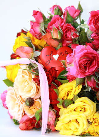 bouquet of multicolored roses, small sprays, with a heart photo
