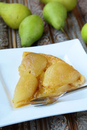 French traditional pie Tarte Tatin with pears  photo