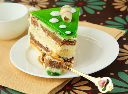 Delicious colorful piece of cake on the plate Stock Photo - 10643087