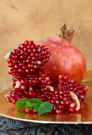 Pomegranates, whole and cut open  photo