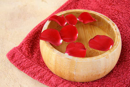 pebblestone: spa concept with rose petals and a red towel