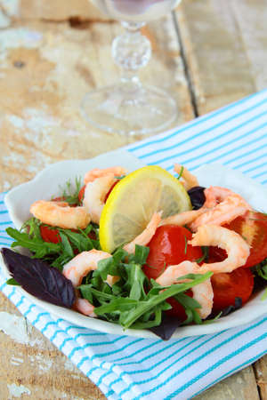 salad with shrimp, herbs and vegetables photo