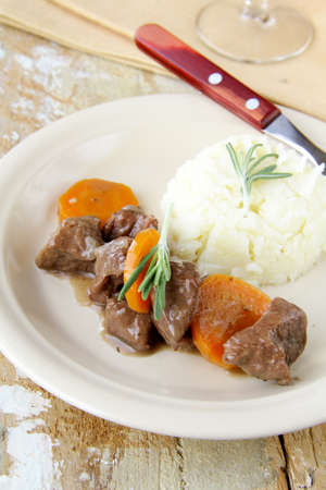 homely: Traditional beef goulash, topped with potato. Delicious homely food Stock Photo