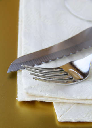 Fork and knife and glass in elegant setting  photo