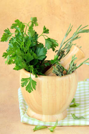 herbs in wooden mortar with pestle  photo