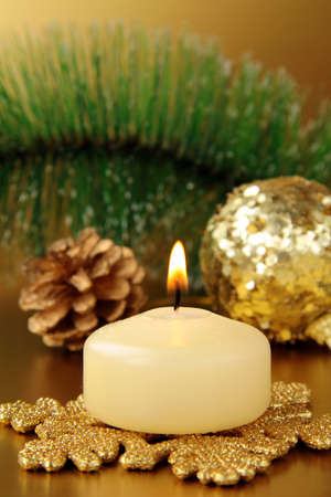 Christmas decoration,  fir sprig, candle and cones photo
