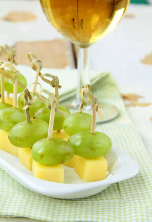 appetizer canape cheese with white grapes on bamboo skewers Stock Photo - 11104396