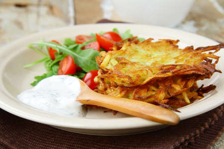 potato pancakes with dill and sour cream photo