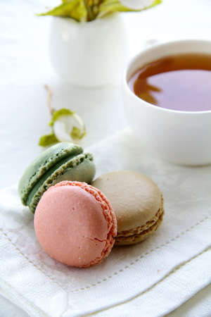 traditional french macarons with tea set on the background Stock Photo - 11104448