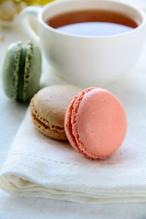 traditional french macarons with tea set on the background  photo