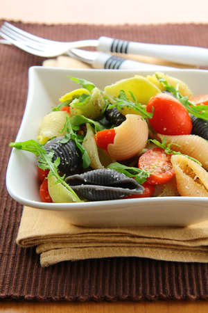 pasta salad with tomatoes and arugula in the Italian style  photo