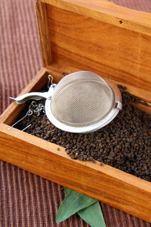tea strainer with a fragrant black tea photo