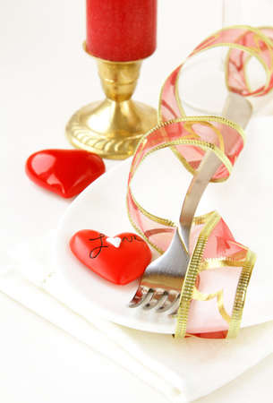 romantic and elegant table setting with hearts  photo