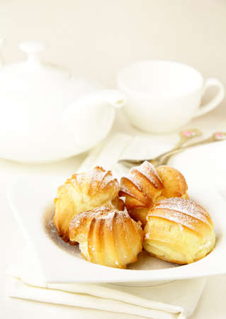 cake profiteroles on a plate, white background  photo